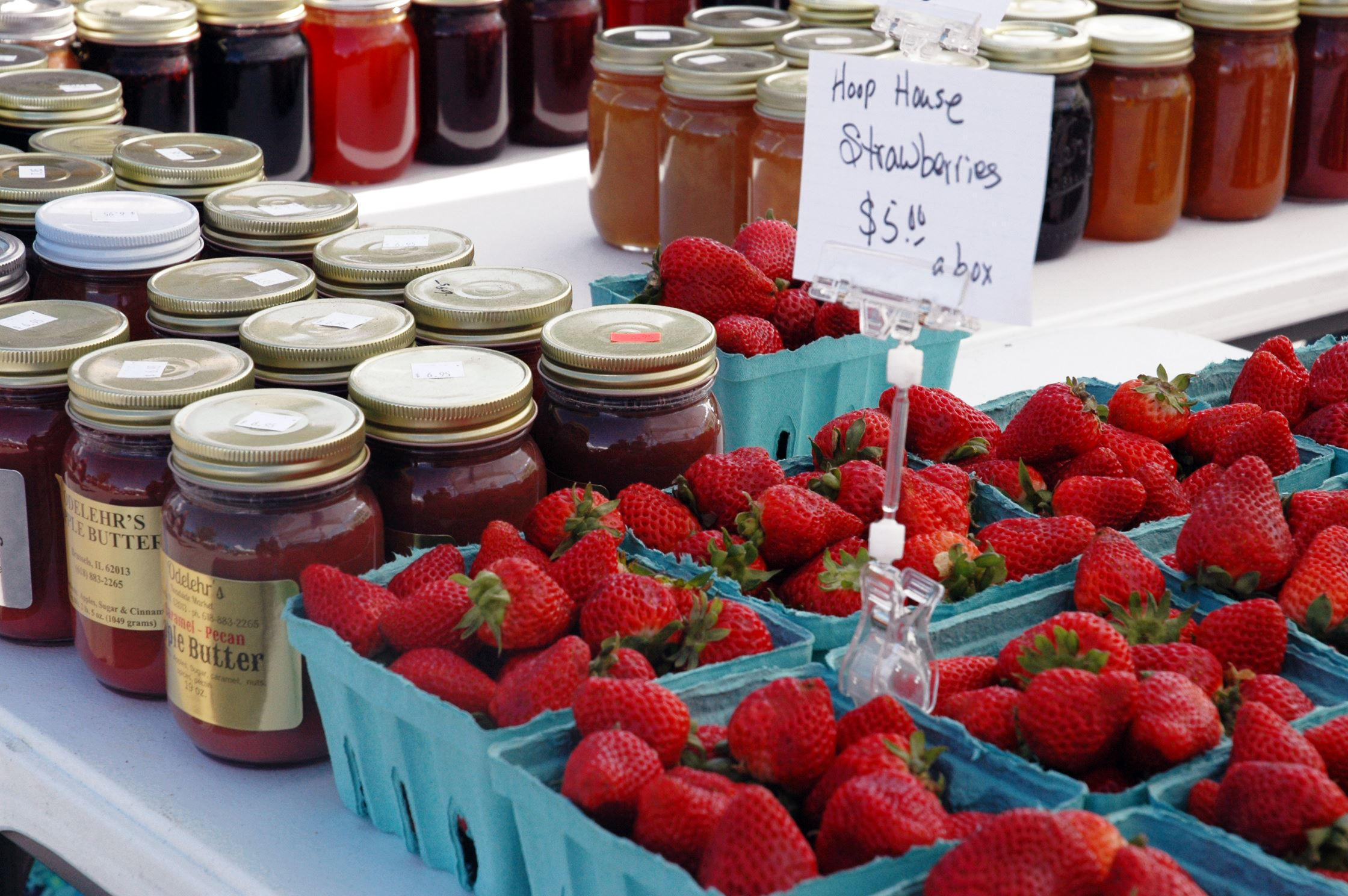 Strawberries and jam for sale
