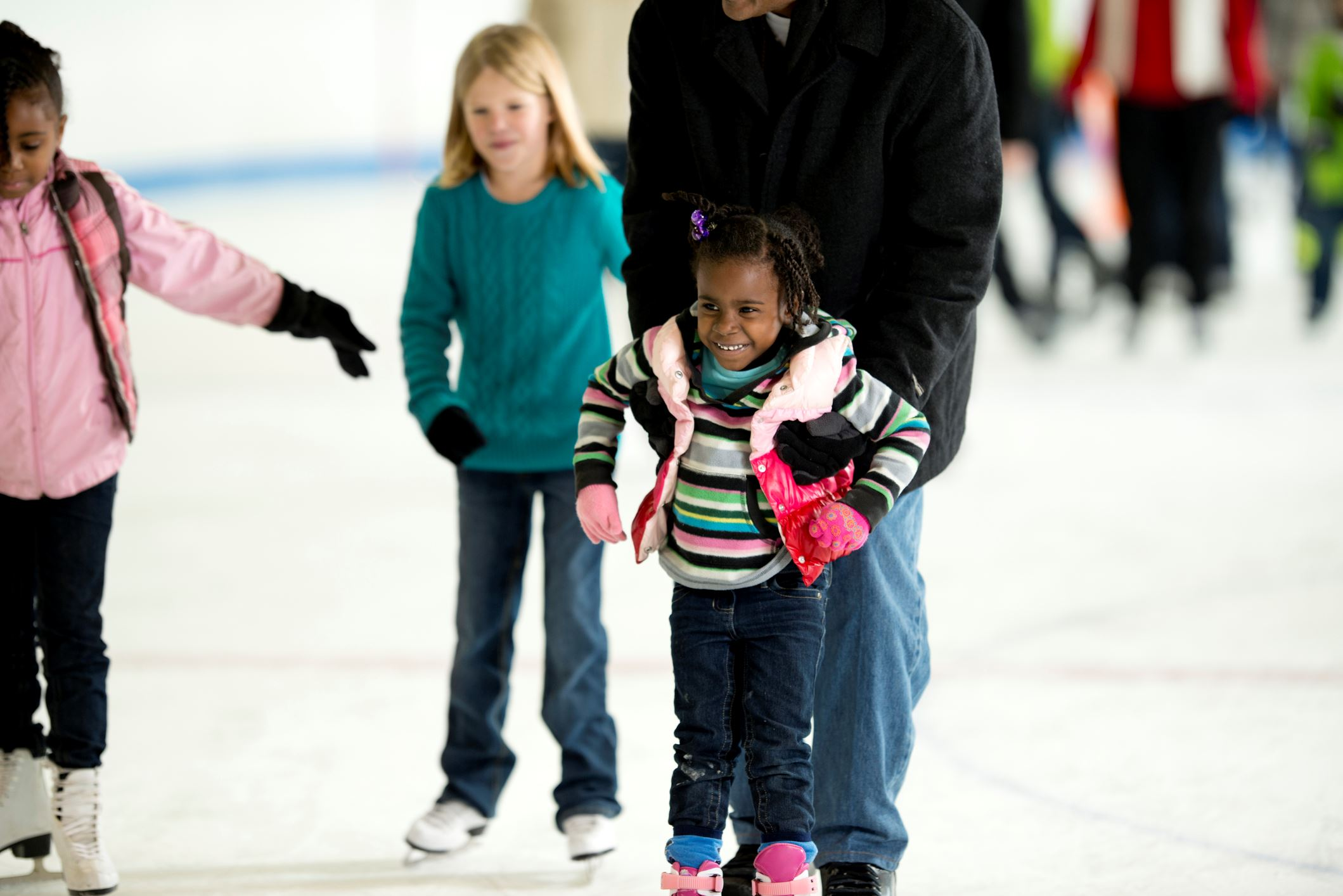 Girl learning to ice skate