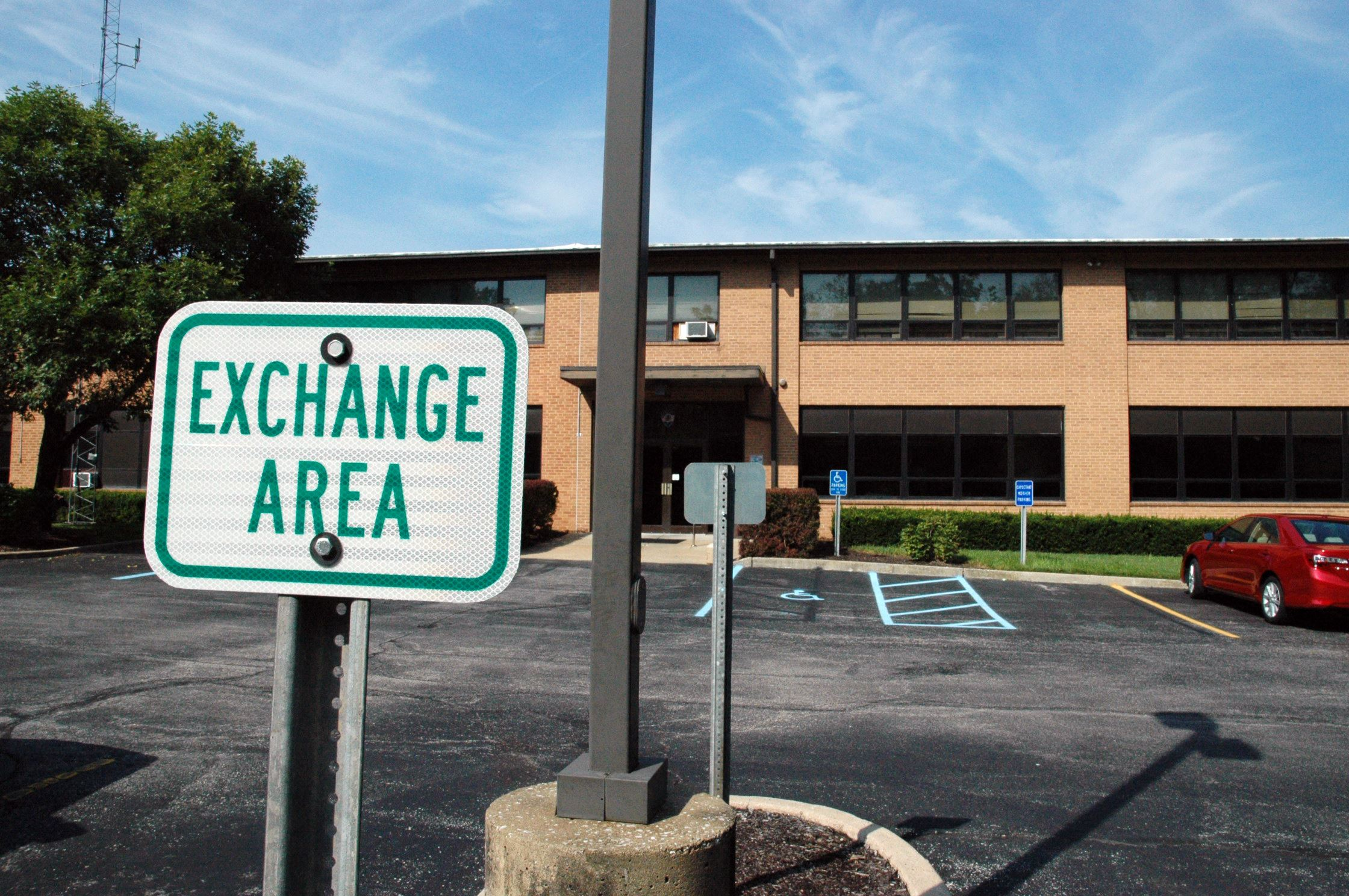 Exchange Location Sign in Parking Lot Outside Rear Entrance of the Creve Coeur Government Center