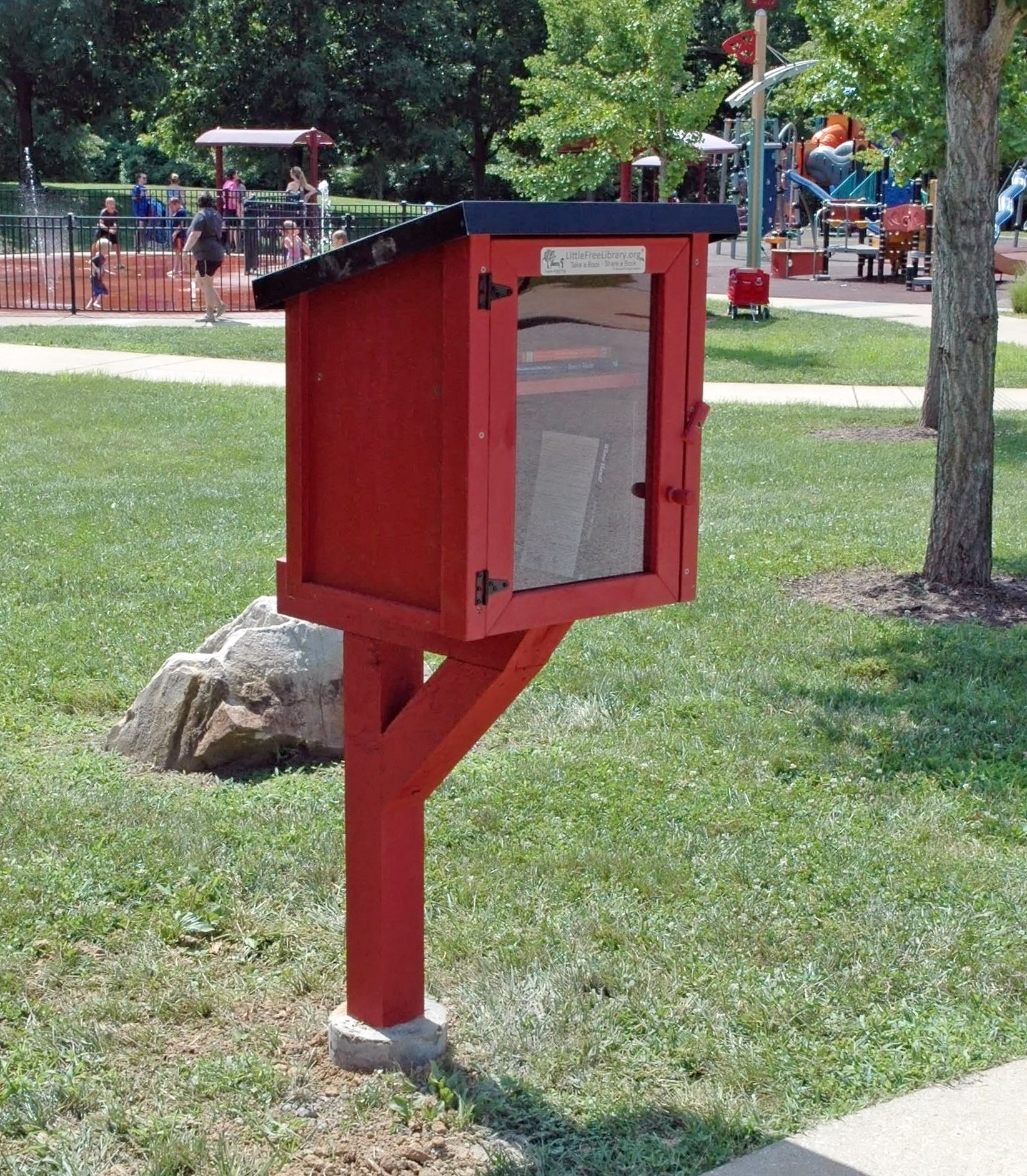Red wooden Little Free Library installed at Millennium Park